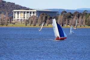 Sails on Lake Burley Griffin against the  National Library of Australia. (Aug-2013)