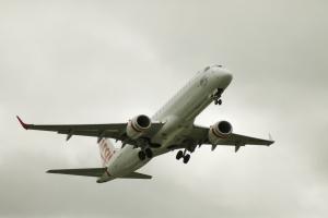 Virgin Jet (VH-ZPT) putting wheels up after take-off Canberra Airport